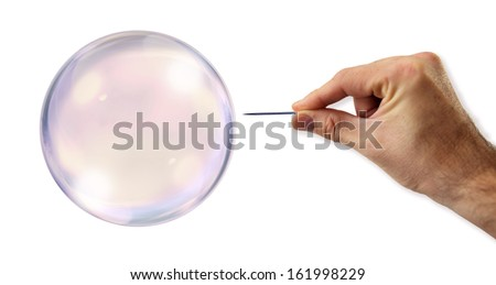 Bubble about to explode by a needle - stock photo