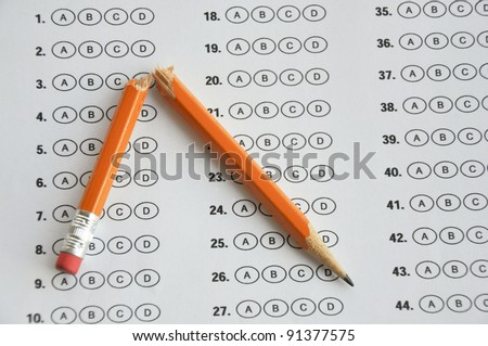Bubble answer sheet with broken pencil - stock photo