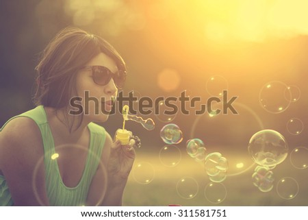 Bubble blower woman - stock photo