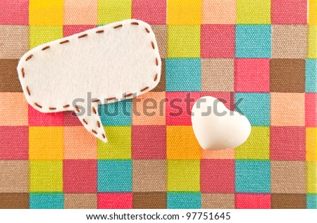 bubble fabric and heart model on color Scotch fabric - stock photo