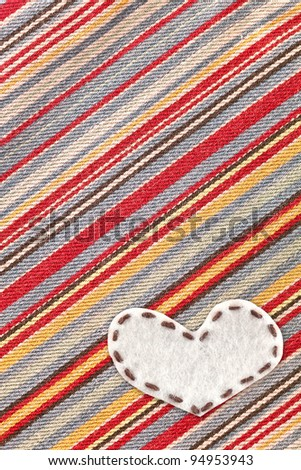 bubble fabric on color jean, love symbol - stock photo