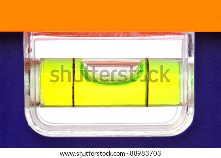Bubble right in the middle of a level tool - stock photo
