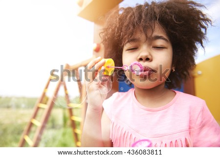 Bubble soap at the playground  - stock photo