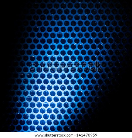 Bubble wrap lit by blue light. Abstract background. - stock photo
