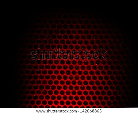 Bubble wrap lit by red light. Abstract background. - stock photo
