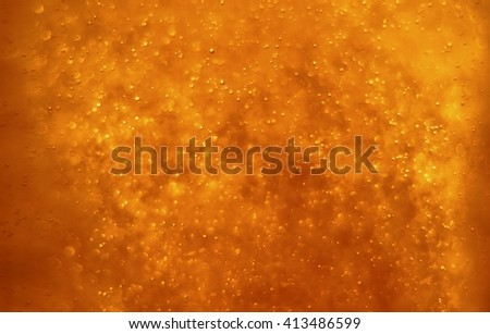 Bubbles floating in the liquid red drink, abstract image. - stock photo