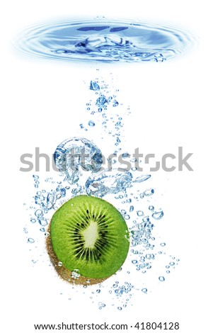 Bubbles forming in blue water after kiwi is dropped into it. - stock photo