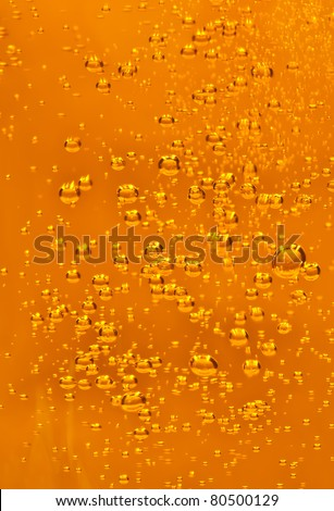 Bubbles in fizz beverage - stock photo