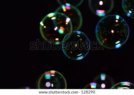 Bubbles on a black background. - stock photo