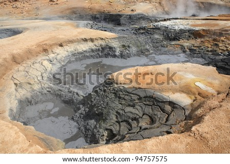 Bubbling mud and cracked earth at Hverir near Myvatn in northern Iceland - stock photo