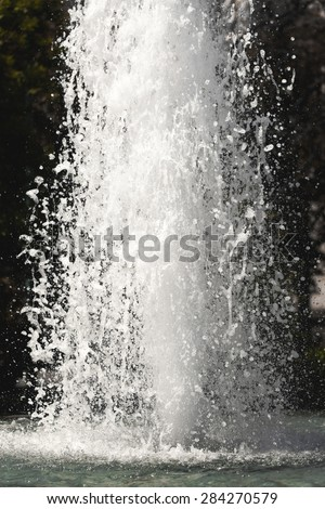 Bubbling streams of water in a fountain with foam closeup - stock photo