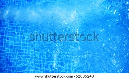 bubbly blue water in a pool abstract background