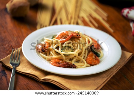 Bucatini with prawns and zucchini - stock photo
