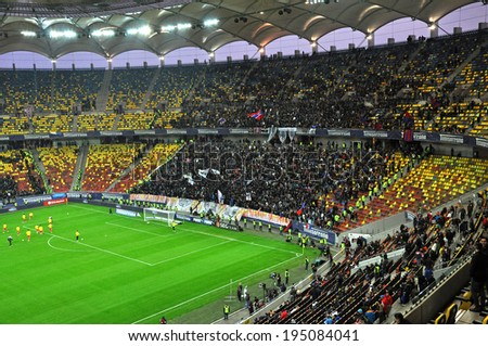 BUCHAREST - APRIL 17: National Arena stadium full with crowd of fans during a match between Dinamo and Steaua Bucharest. On April 17, 2014 in Bucharest, Romania  - stock photo