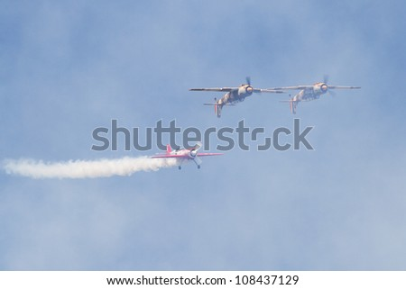 "BUCHAREST - JULY 21: ""Iacarii Acrobati and Jurgis Kairys"" perform at Bucharest International Air Show & General Aviation Exhibition (BIAS 2012) on July 21, 2012 in Bucharest, Romania"
