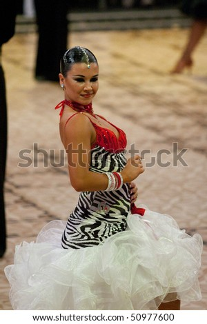 BUCHAREST - MARCH 14: Latin dancer at IDSF Dance Masters on March 14, 2010 in Bucharest, Romania.