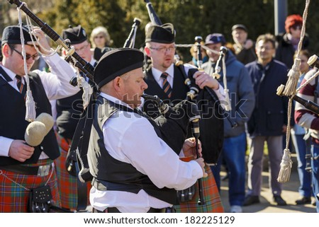 BUCHAREST - MARCH 16: Senior bagpipers dressed in traditional Irish uniforms perform at the 2nd St. Patrick's Day Parade on March 16, 2014 in Bucharest, Romania.