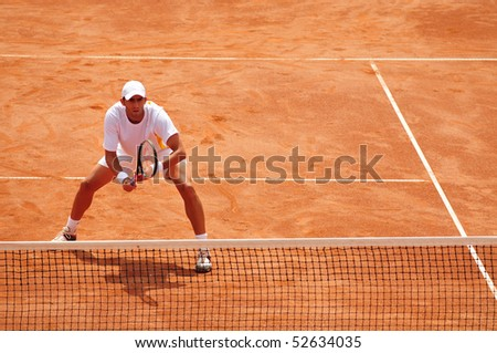 BUCHAREST, ROMAINIA  MAY 8: Romania's Horia Tecau is waiting to return the ball during the Davis Cup meeting between Romania and Ukraine at the BNR Arenas on May 8, 2010 in Bucharest, Romania. - stock photo