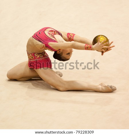BUCHAREST, ROMANIA - APRIL 3: Ana Toma performs during the Irina Deleanu Orange Trophy on April 3, 2011 in Bucharest, Romania - stock photo