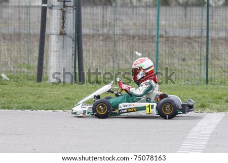 BUCHAREST, ROMANIA - APRIL 9: Andrei Ponta competes in National Karting Championship on April 9, 2011 in Bucharest, Romania.