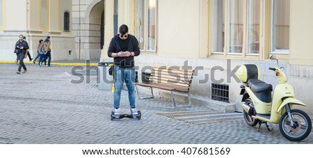 BUCHAREST, ROMANIA, - April 10, 2016: Boy using hoverboard, a self-balancing two-wheeled board. The gyroscope based dual wheel electric scooter is also called a smart balance wheel.