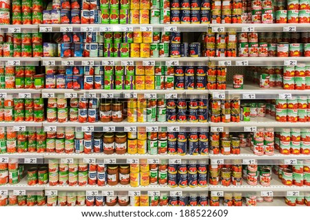 BUCHAREST, ROMANIA - APRIL 20, 2014: Canned Food On Supermarket Stand. - stock photo