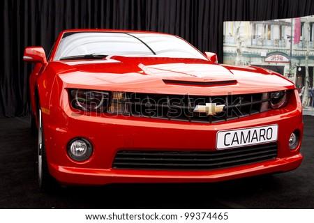 "BUCHAREST, ROMANIA - APRIL 05: Car exhibition at Bucharest ""BUCHAREST SIAB 2012"", Chevrolet Camaro. April 05, 2012, Bucharest, Romania. - stock photo"