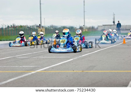 BUCHAREST, ROMANIA - APRIL 10: Florescu Petrut (10) competing in National Karting Championship on April 10, 2011 in Bucharest, Romania