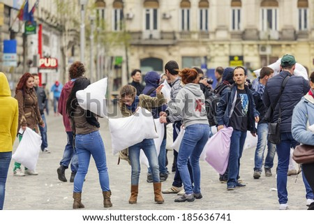 BUCHAREST, ROMANIA - APRIL 5: Group of unidentified people participate in pillow fight on International Pillow Fight Day on April 5, 2014 in University Square, Bucharest, Romania.