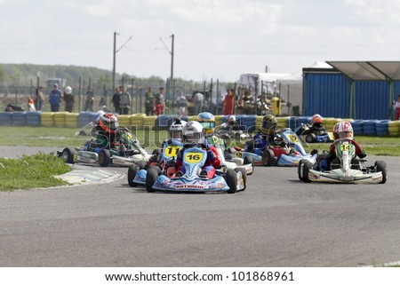 BUCHAREST, ROMANIA - APRIL 21: Leo Borlovan, number 16, competes in National Karting Championship, Round 1, on April 21, 2011 in Bucharest, Romania.