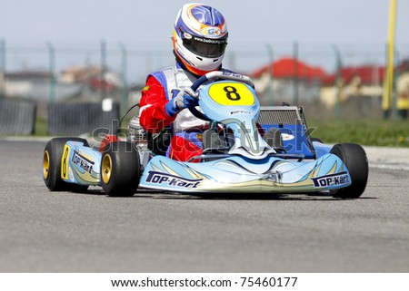 BUCHAREST, ROMANIA - APRIL 9: Mihnea Stefan competes in National Karting Championship on April 9, 2011 in Bucharest, Romania.