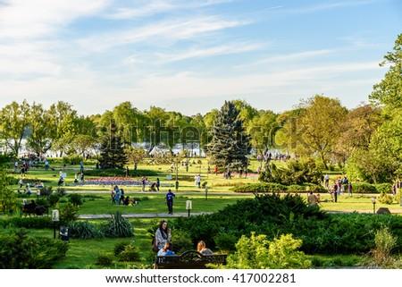 BUCHAREST, ROMANIA - APRIL 16, 2016: People Having Fun In Herastrau Public Park On Spring Day. - stock photo