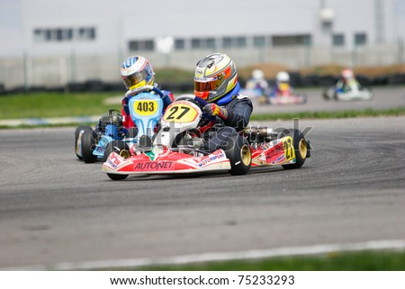 BUCHAREST, ROMANIA - APRIL 10: Vajda Andrei competes in National Karting Championship on April 10, 2011 in Bucharest, Romania