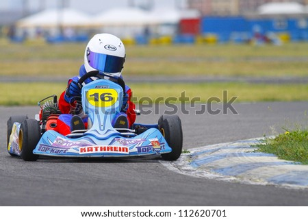 BUCHAREST, ROMANIA - AUGUST 11: Leo Borlovan, number 16, competes in National Karting Championship, Round 5, on august 11, 2012 in Bucharest, Romania.
