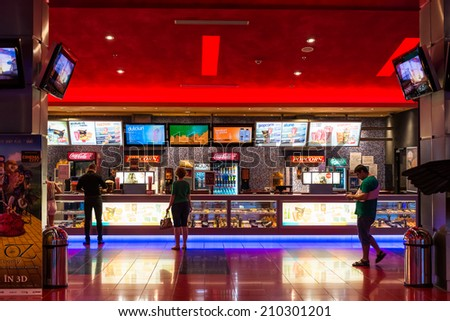 BUCHAREST, ROMANIA - AUGUST 10, 2014: People Buying Popcorn And Soda Drinks At The Cinema Premiere Movies. - stock photo