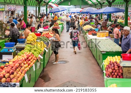 BUCHAREST, ROMANIA - AUGUST 04, 2014: People Shopping For Healthy Food In Fruits And Vegetables Market. - stock photo