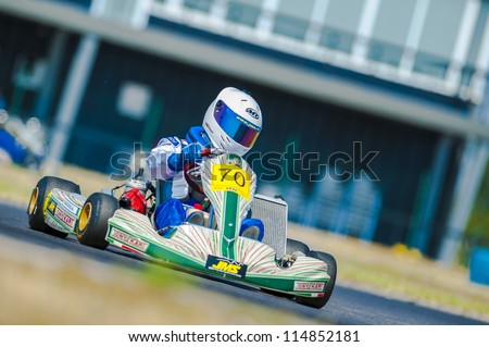 BUCHAREST, ROMANIA - AUGUST 4: Unknown pilots competing in National Karting Championship 2012 at Amkart Bucharest, on August 4, 2012 in Bucharest, Romania - stock photo