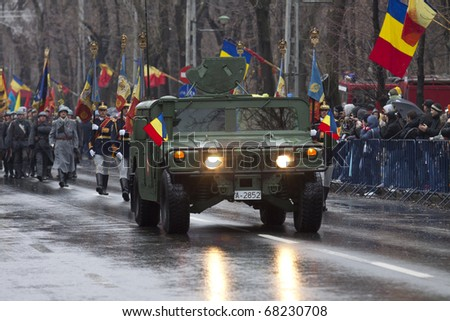 BUCHAREST, ROMANIA - DEC. 1: Hummer H1, military vehicle, open The Military Parade on National Day of Romania, Arcul de Triumf, December 1, 2010 in Bucharest. - stock photo