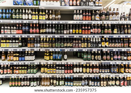 BUCHAREST, ROMANIA - DECEMBER 06, 2014: Beer Bottles On Supermarket Stand. - stock photo