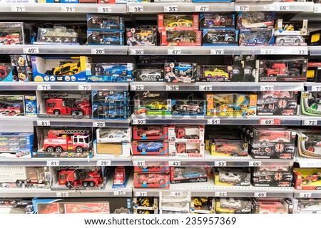 BUCHAREST, ROMANIA - DECEMBER 06, 2014: Car Toys For Small Children On Supermarket Stand. - stock photo