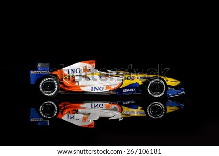 BUCHAREST, ROMANIA - DECEMBER 27: Collectible toy model, Renault F1 Team 2007 on black background, December 27, 2014, in Bucharest, Romania   - stock photo