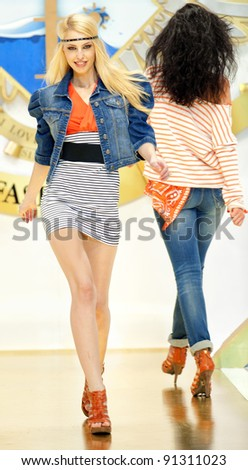 BUCHAREST, ROMANIA - DECEMBER 3: Fashion model wears clothes from BSB collection, in Bucharest Fashion Week at World Trade Center on December 3, 2011 in Bucharest, Romania - stock photo