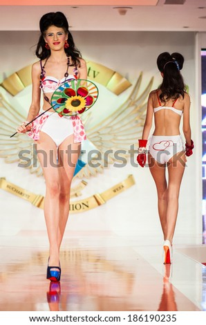 BUCHAREST, ROMANIA - DECEMBER 3: Fashion model wears clothes made by Catalin Botezatu in Bucharest Fashion Week on December 3, 2012, Bucharest, Romania - stock photo