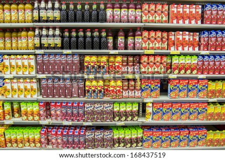 BUCHAREST, ROMANIA - DECEMBER 20, 2013: Natural Juice Bottles On Supermarket Stand. Juice is prepared by mechanically squeezing or macerating fruit or vegetable flesh without the application of heat. - stock photo