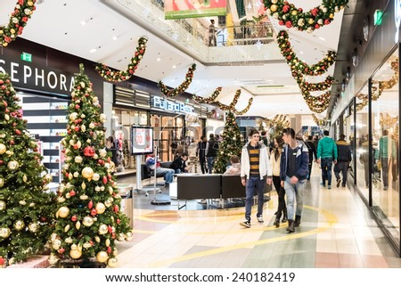 BUCHAREST, ROMANIA - DECEMBER 24, 2014: People Shopping For Christmas In Luxury Shopping Mall Interior. - stock photo
