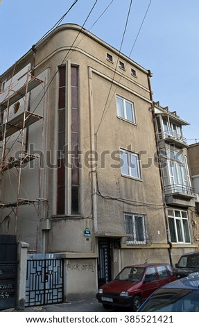 BUCHAREST, ROMANIA - 23 FEBRUARY 2016: A classic art deco apartment building stands defaced and in need of removation in Strada Mogos Vornicul.