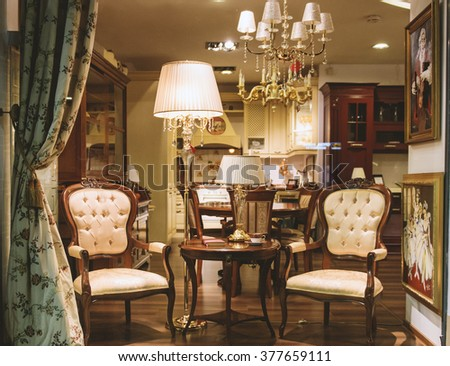 Bucharest, Romania - February 11, 2016: Luxury furniture in an elegant shop storefront. - stock photo