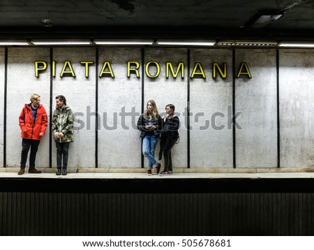 Bucharest, Romania, 21 February 2016: Teenagers are waiting for the metro in Piata Romana subway station in Bucharest.