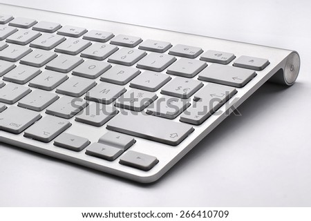 BUCHAREST, ROMANIA - JAN 7, 2015 Close up of the typical Mac Keyboard of an Apple wireless Computer - stock photo