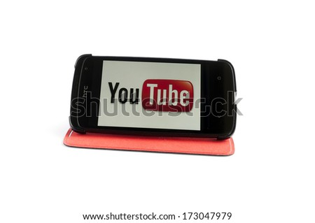 Bucharest, Romania-Jan 24, 2014:Photo of YouTube on smartphone screen. YouTube is a video-sharing website, created by three former PayPal employees in February 2005 and owned by Google since late 2006 - stock photo